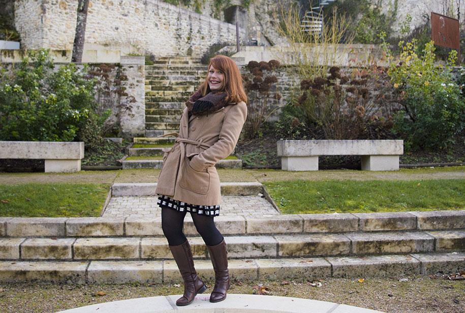 Photo de Sandie au milieu d'un parc avec le sourire