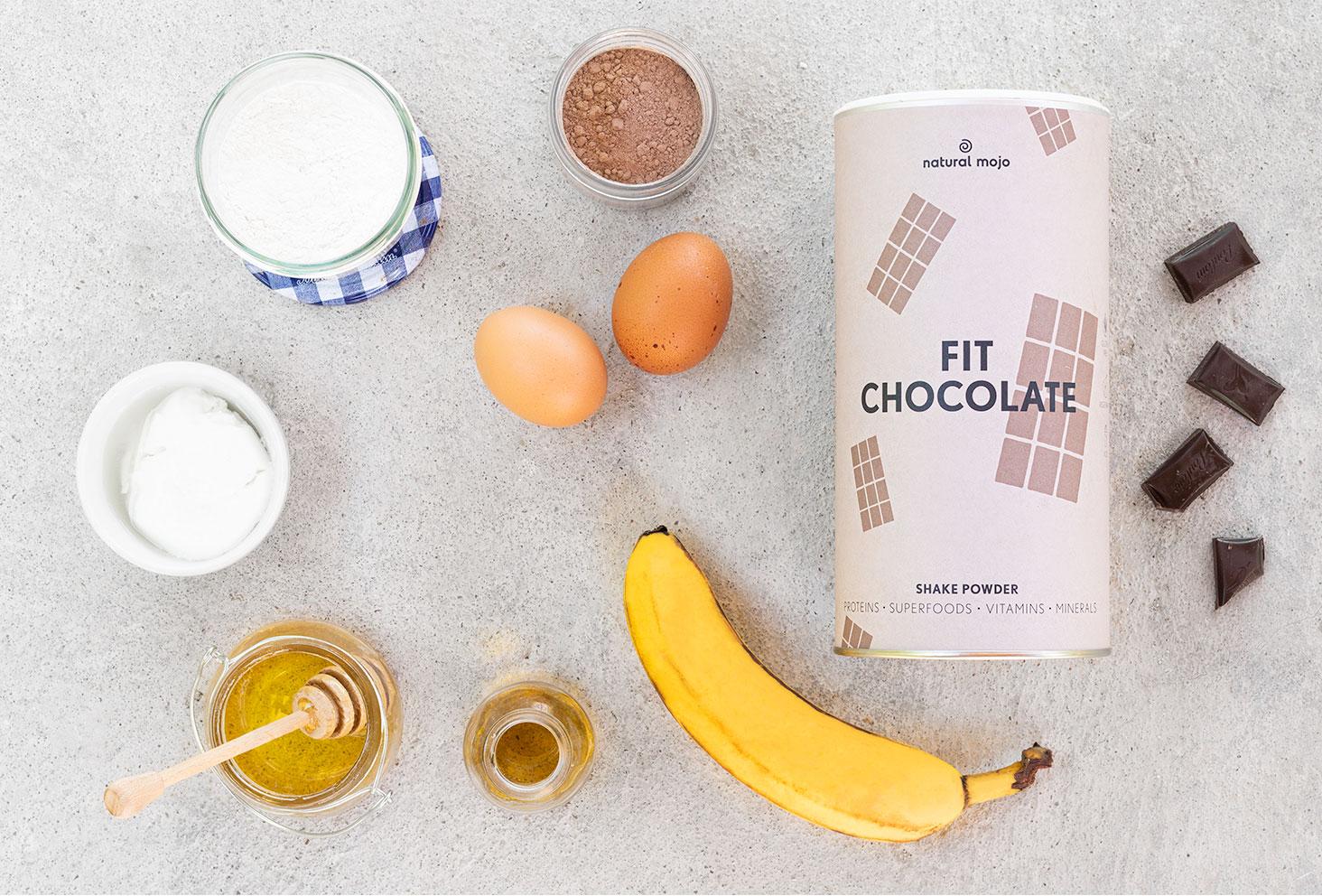 Ingrédients pour la recette du banana bread protéiné avec le Fit Chocolate de Natural Mojo